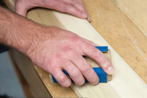 sanding wooden panels